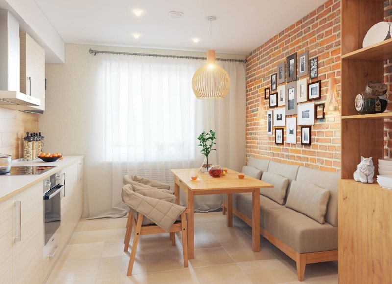Узкий прямой диван вдоль кирпичной стены