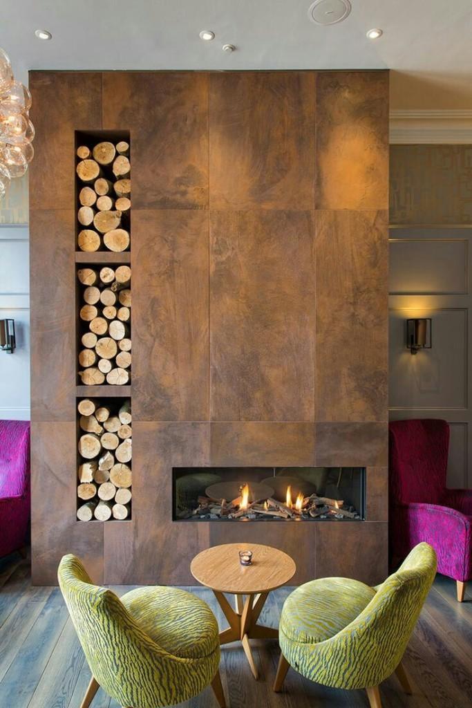 Стильный камин с местом для хранения дров