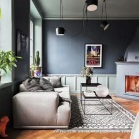 Интерьер гостиной с серыми стенами