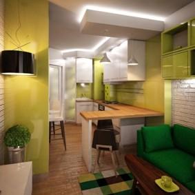 Зеленый диван в зоне отдыха кухни-гостиной