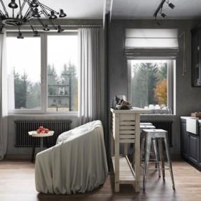 Дизайн кухни с диваном в сером цвете