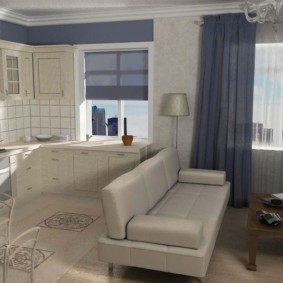 Прямой диван посередине кухни-гостиной