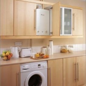 Стиральная машинка в интерьере кухни