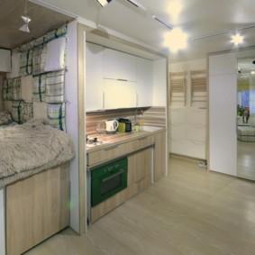 Кровать на подиуме в квартире студии