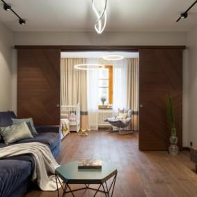 Интерьер гостиной в трехкомнатной квартире