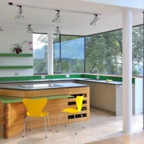 Кухня в частном доме с большими окнами
