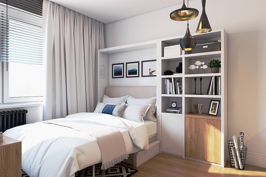 Удобная кровать в интерьере квартиры-студии