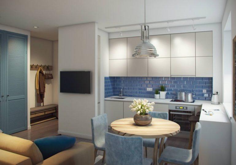 Угловой гарнитур в кухне-гостиной с диваном