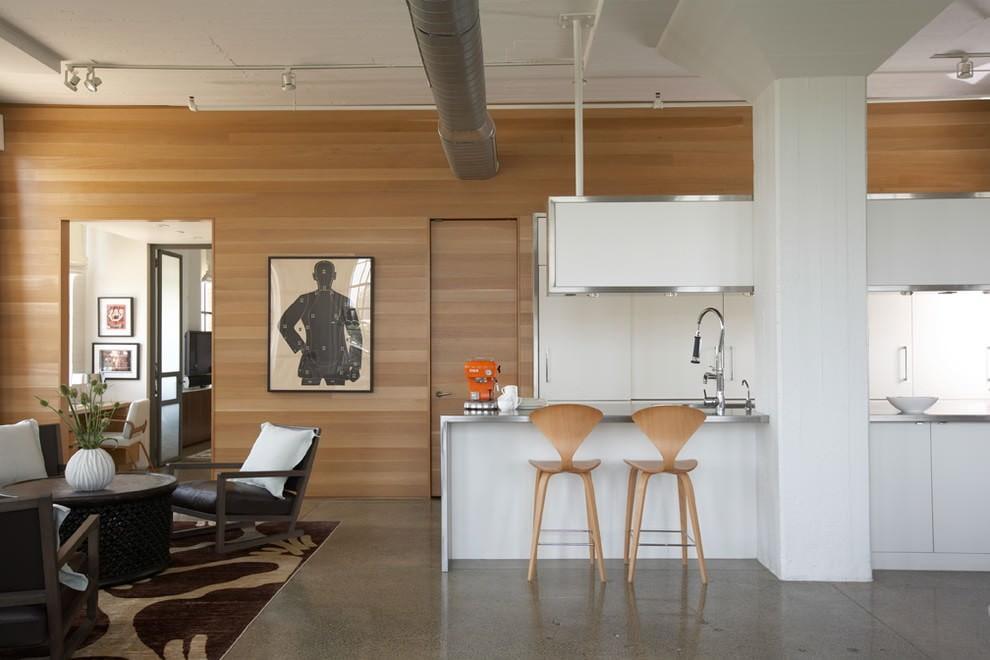 Отделка ламинатом стены в кухне-гостиной