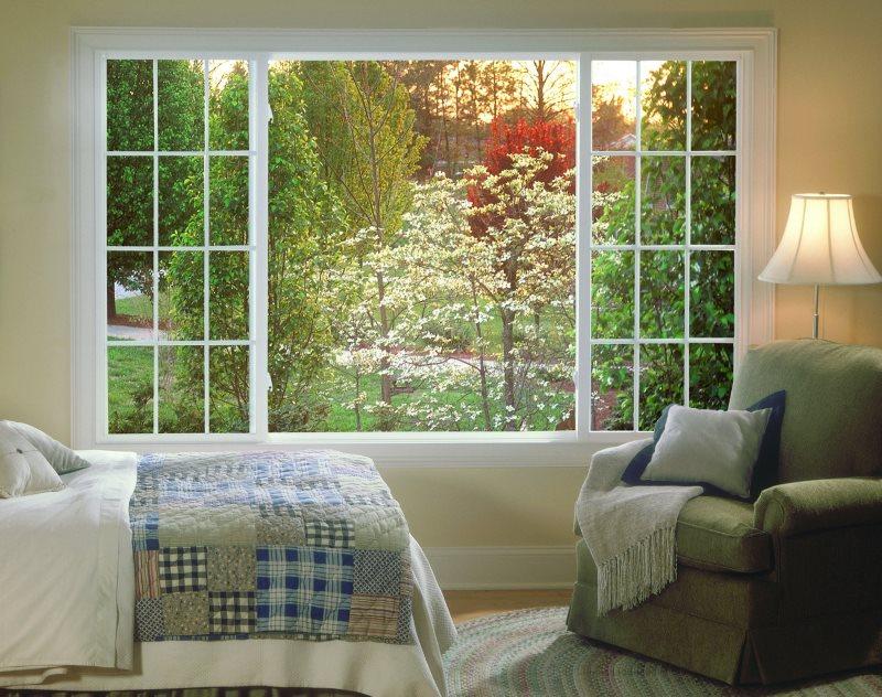 Фотообои с пейзажем в фальш-окне спальной комнаты