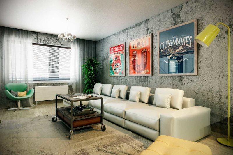 Украшение плакатами стены над диваном