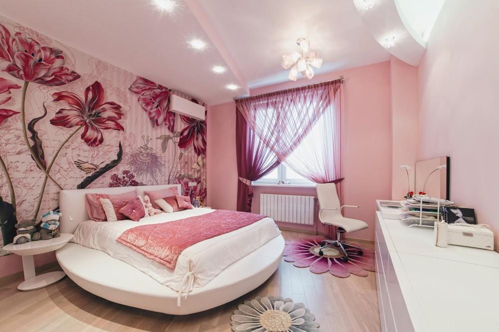 Круглая кровать в спальне розового цвета