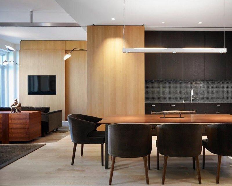 Зонирование кухни-гостиной большим ковром