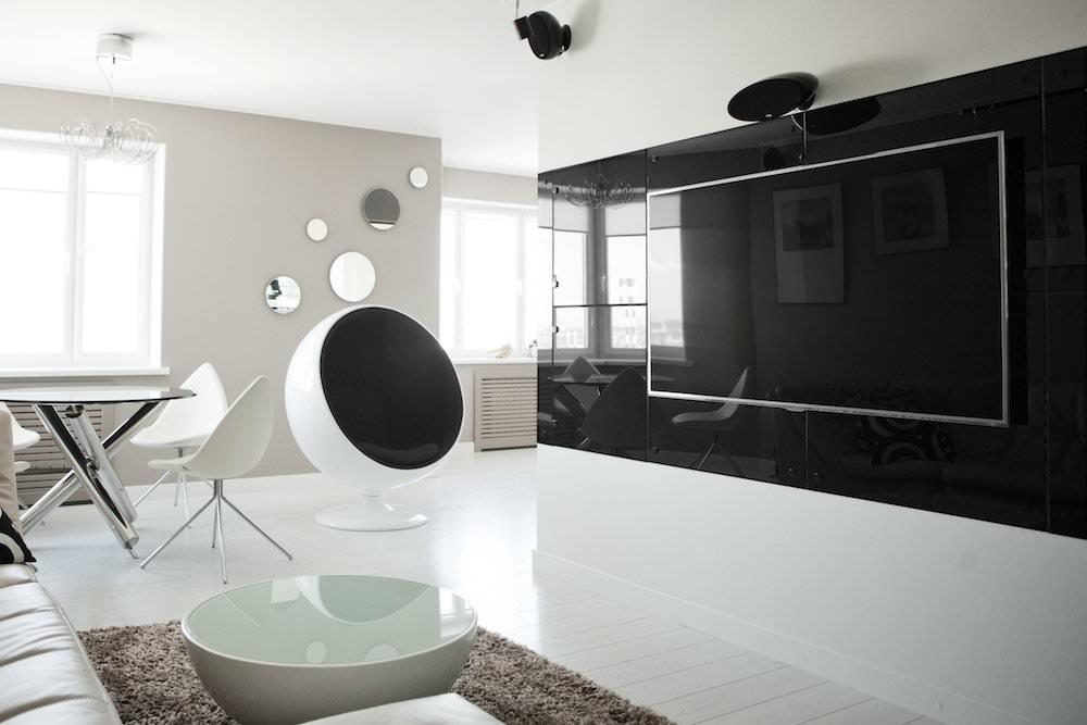 Черная стена в интерьере гостиной в стиле хай-тек