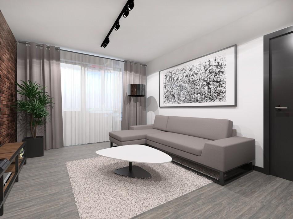 Серый диван на фоне белой стены в однокомнатной квартире