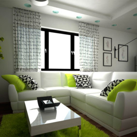 Зеленые подушки на кожаном диване