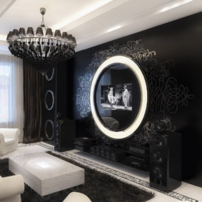 Телевизионная панель на черной стене