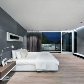 Дизайн спальной комнаты с серой стеной