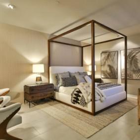 Зонирование спальни большим ковром