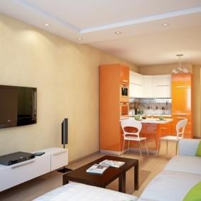 Оранжевый гарнитур в кухне гостиной