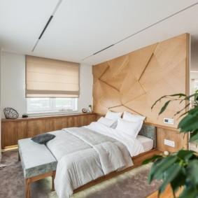 Декор деревянными панелями стены в спальне