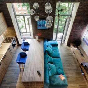 Зонирование комнаты диваном и барной стойкой