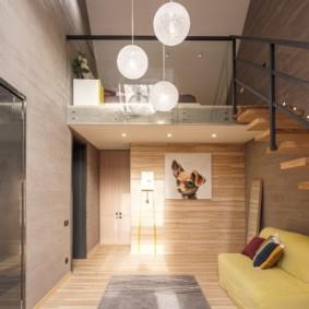 Прямой диван в пространстве под лестницей