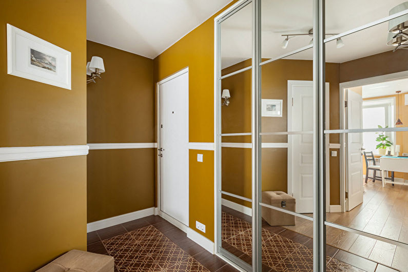 прихожая в современном стиле с крашеными стенами