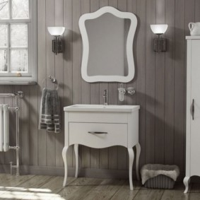 Белая мебель на фоне серой стены