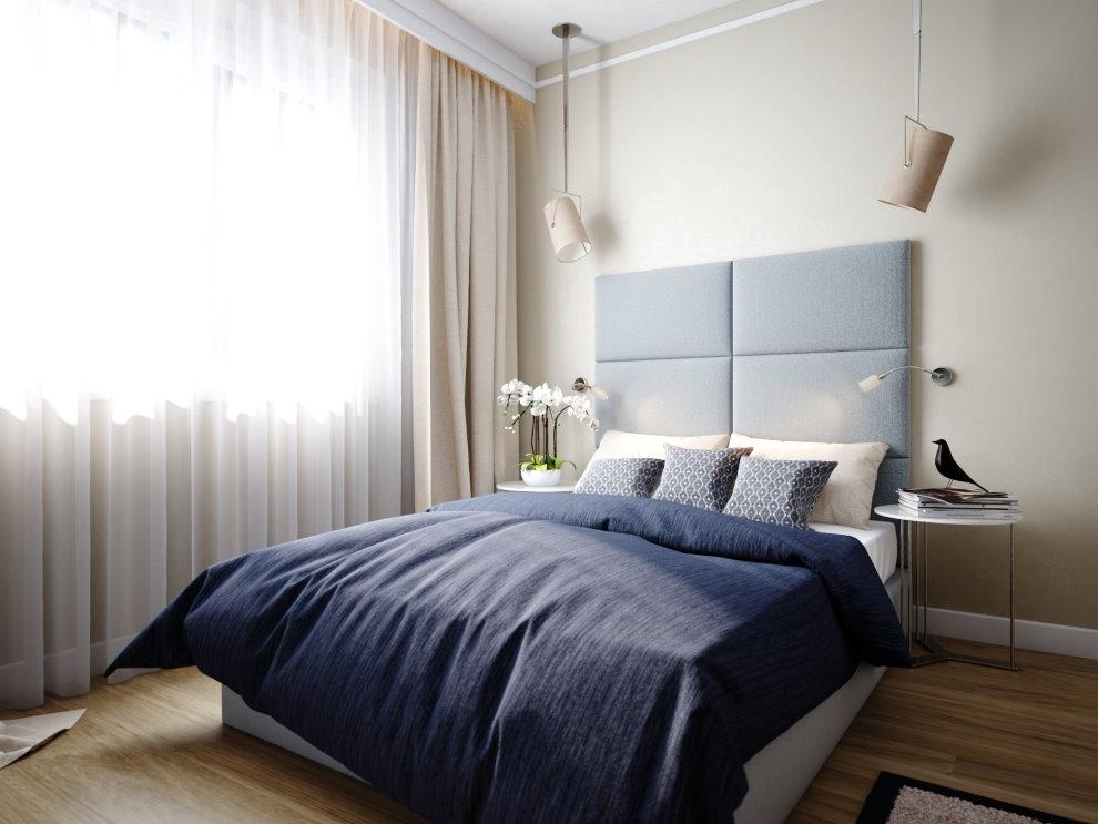 Серое панно над кроватью в спальной зоне квартиры