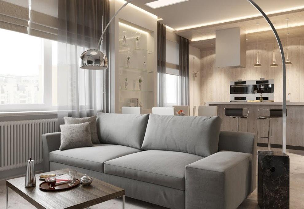 Прямой серый диван в кухне-гостиной двухкомнатной квартиры