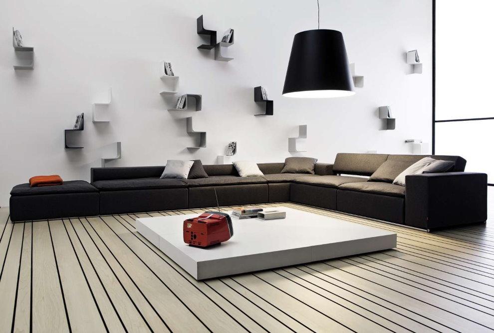 Низкий угловой диван в гостиной стиля минимализм