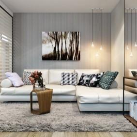 Дизайн современной гостиной с диваном углового типа