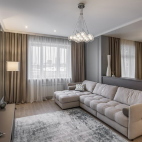 Угловой диван в гостиной зоне квартиры студии