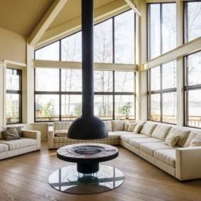 Островной камин в гостиной современного стиля
