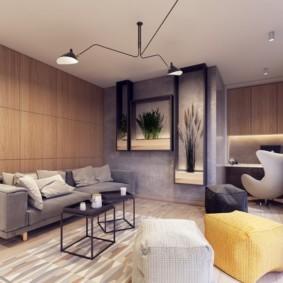 Серый диван вдоль стены с деревянными панелями