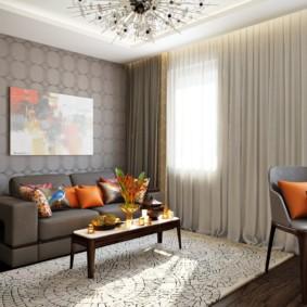 Оранжевые подушки в небольшой комнате