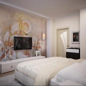 Телевизор на стене спальни с фотообоями