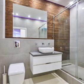 Подвесная тумба на стене ванной
