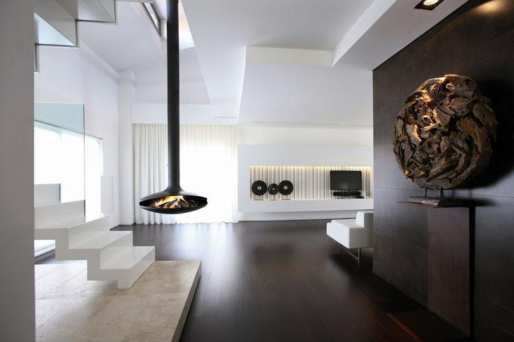 Гостиная в стиле минимализма с островным камином