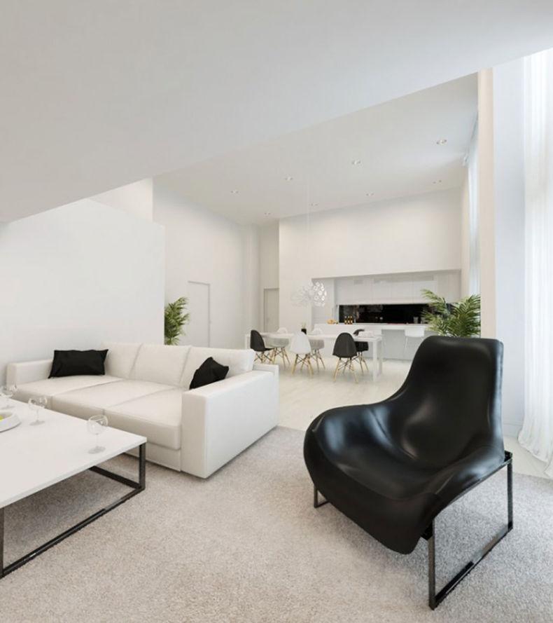 Черное кресло в белоснежной гостиной