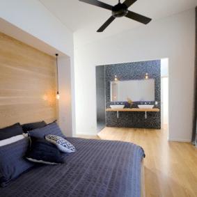ламинат на стене в спальне интерьер фото