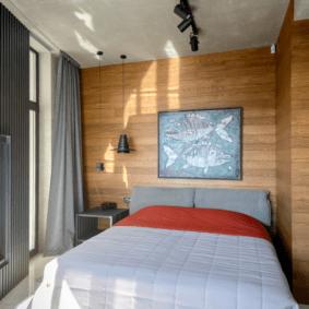 ламинат на стене в спальне фото интерьер