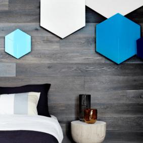 ламинат на стене в спальне оформление
