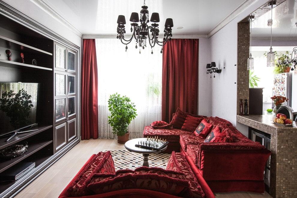Бардовый текстиль в интерьере зала стиля арт деко