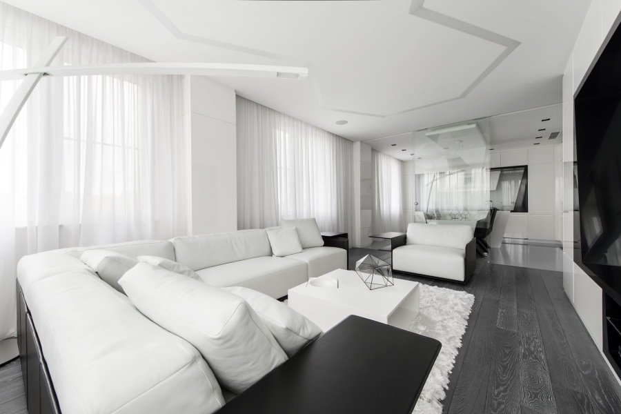 Угловой диван белого цвета в стиле хай-тек