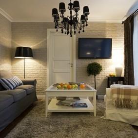 Освещение гостиной с кирпичными стенами