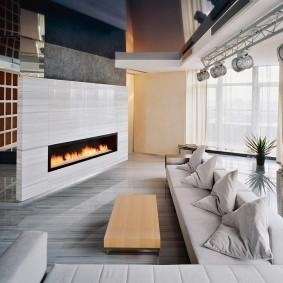 Электрокамин в гостиной стиля хай тек