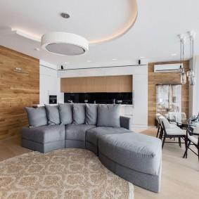 Серый диван оригинальной формы