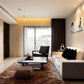 Декоративная подсветка модульных картин на стене гостиной